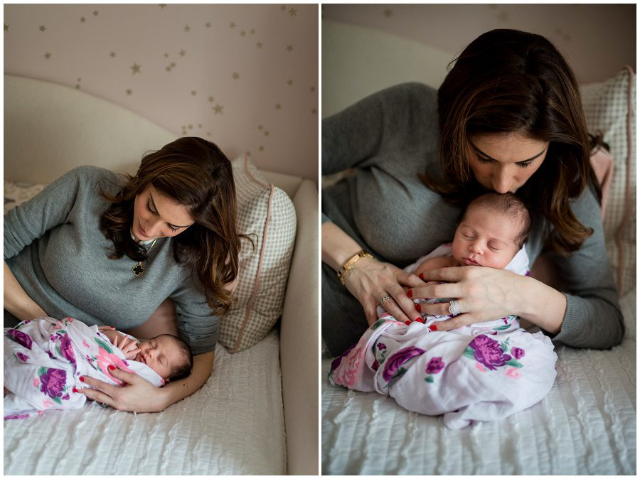photo of mother looking at newborn that is on a daybed at home session swaddled in wrap