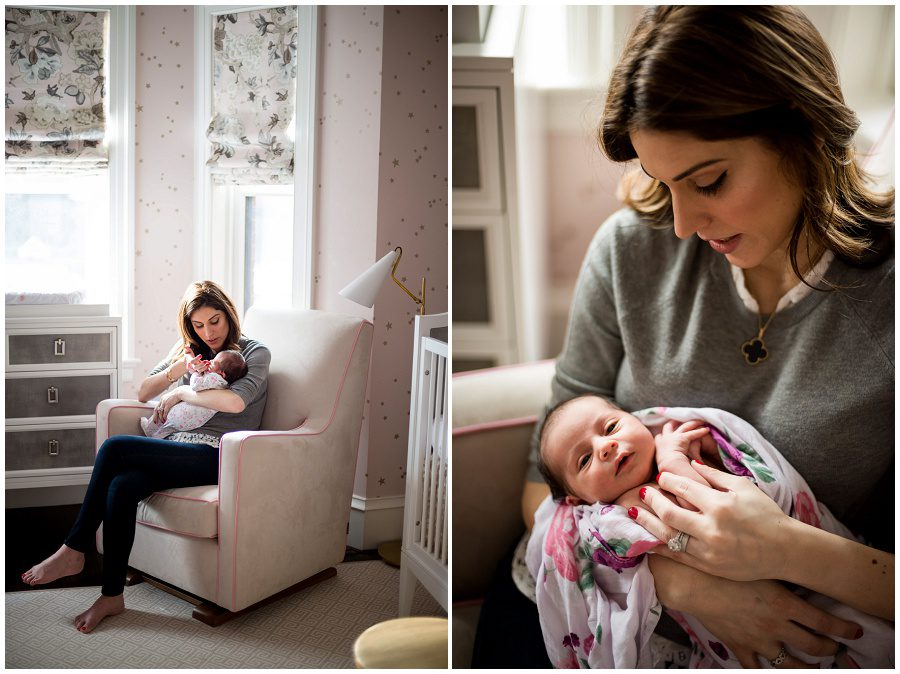 Mother soothes her newborn baby as she sits in a rocking chair in her nursery