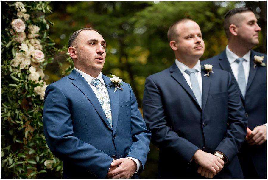 Groom sees his bride coming towards him down the aisle