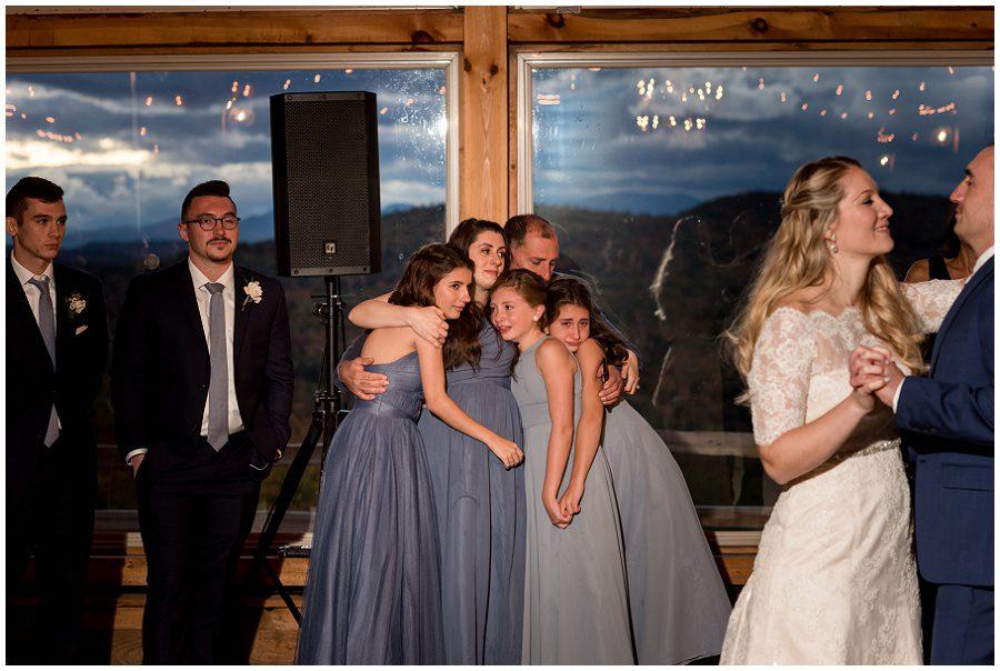 bridesmaids crying during emotional first dance.
