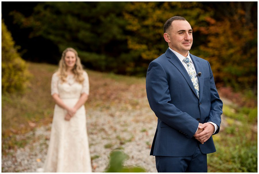 First look moment focus on the groom at Granite Ridge Estate and Barn in Norway Maine