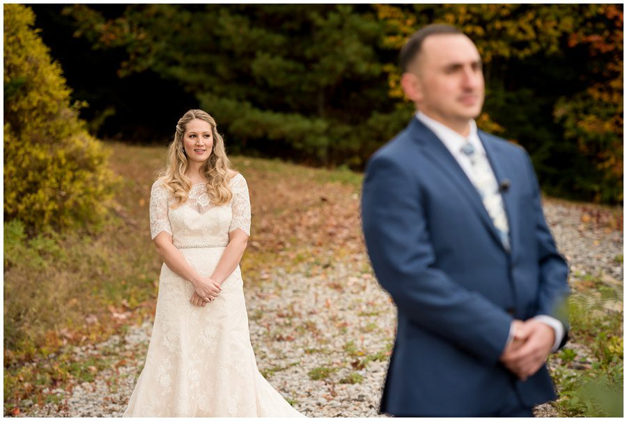First look moment focus on the bride at Granite Ridge Estate and Barn in Norway Maine