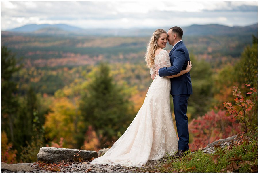 Couples portraits of the bride and groom with fall foliage at Granite Ridge Estate and Barn in Norway Maine