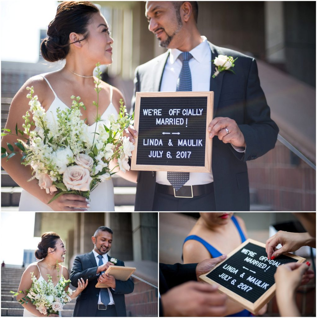 Newlyweds outside Boston City Hall with just married sign