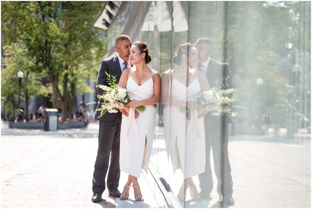 Bride and Groom after wedding civil ceremony posing outside Boston City Hall Faneuil Hall