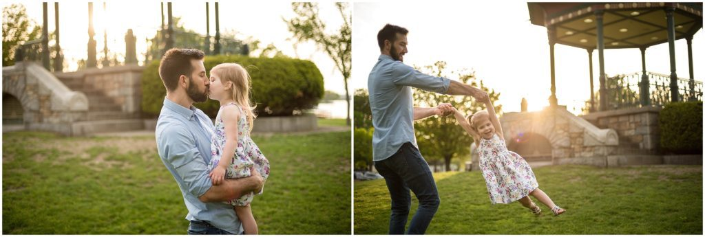 sunset father and daughter twirling during family session in Boston