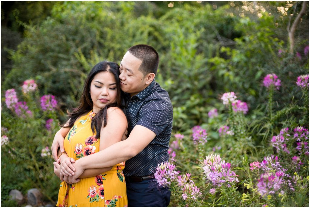 Engagement Photos at The Fens in Boston with spring blossoms in a garden