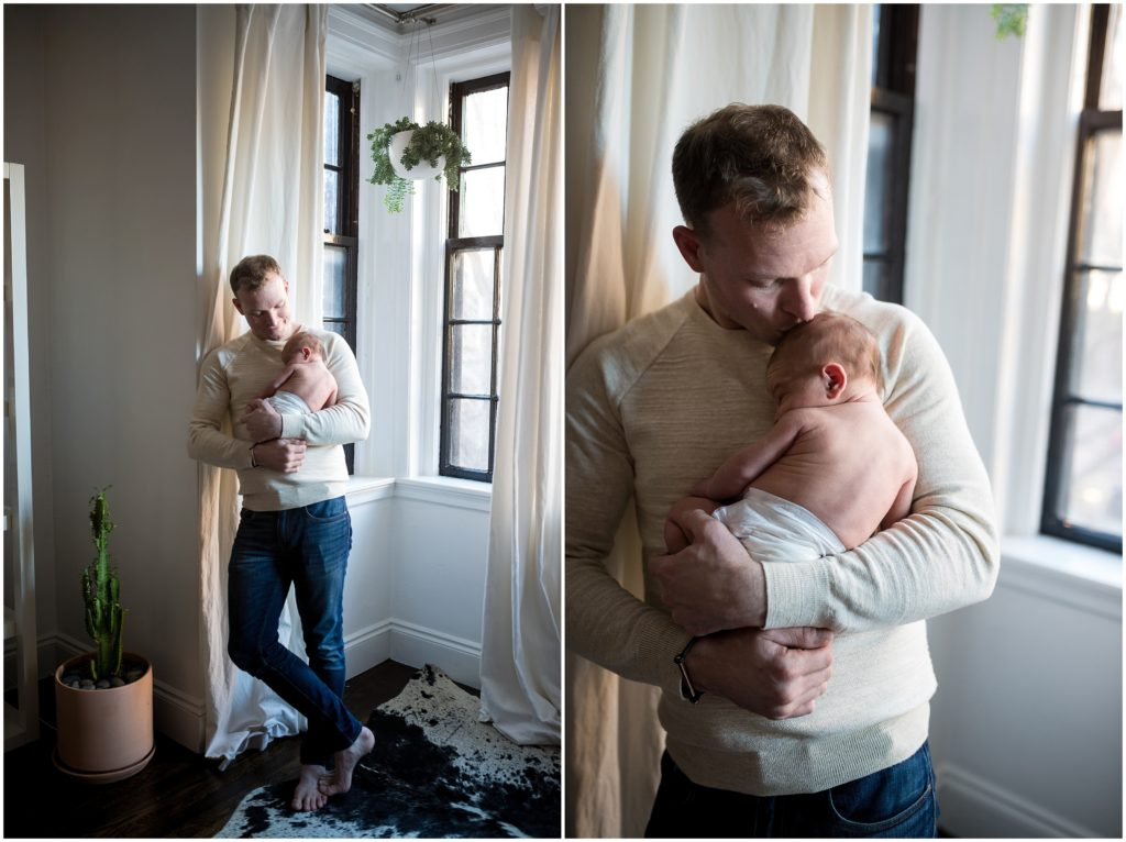 Newborn being held by father