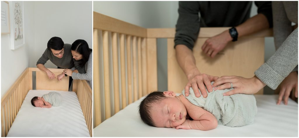 Parents looking at son in crib in his nursery in Boston