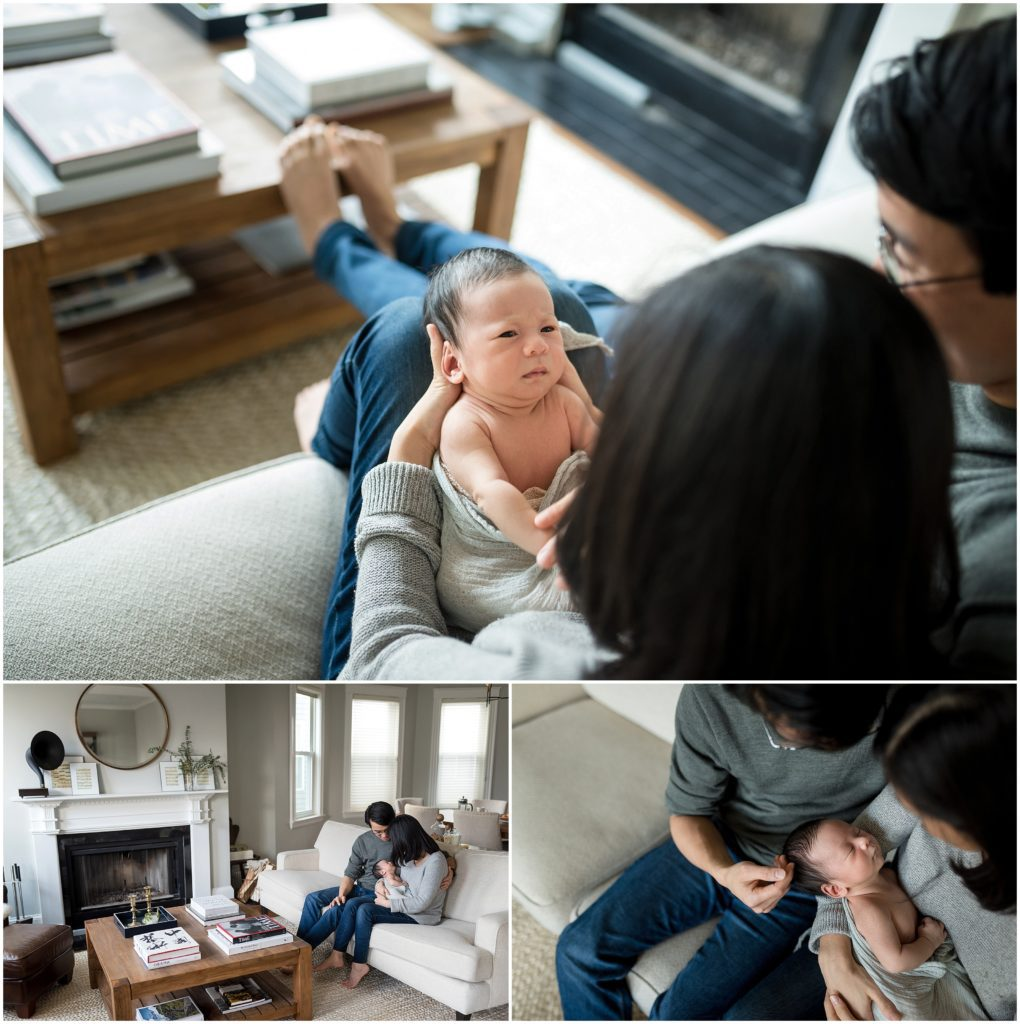 Newborn looking at parents while being held in living room at home during lifestyle session in Cambridge