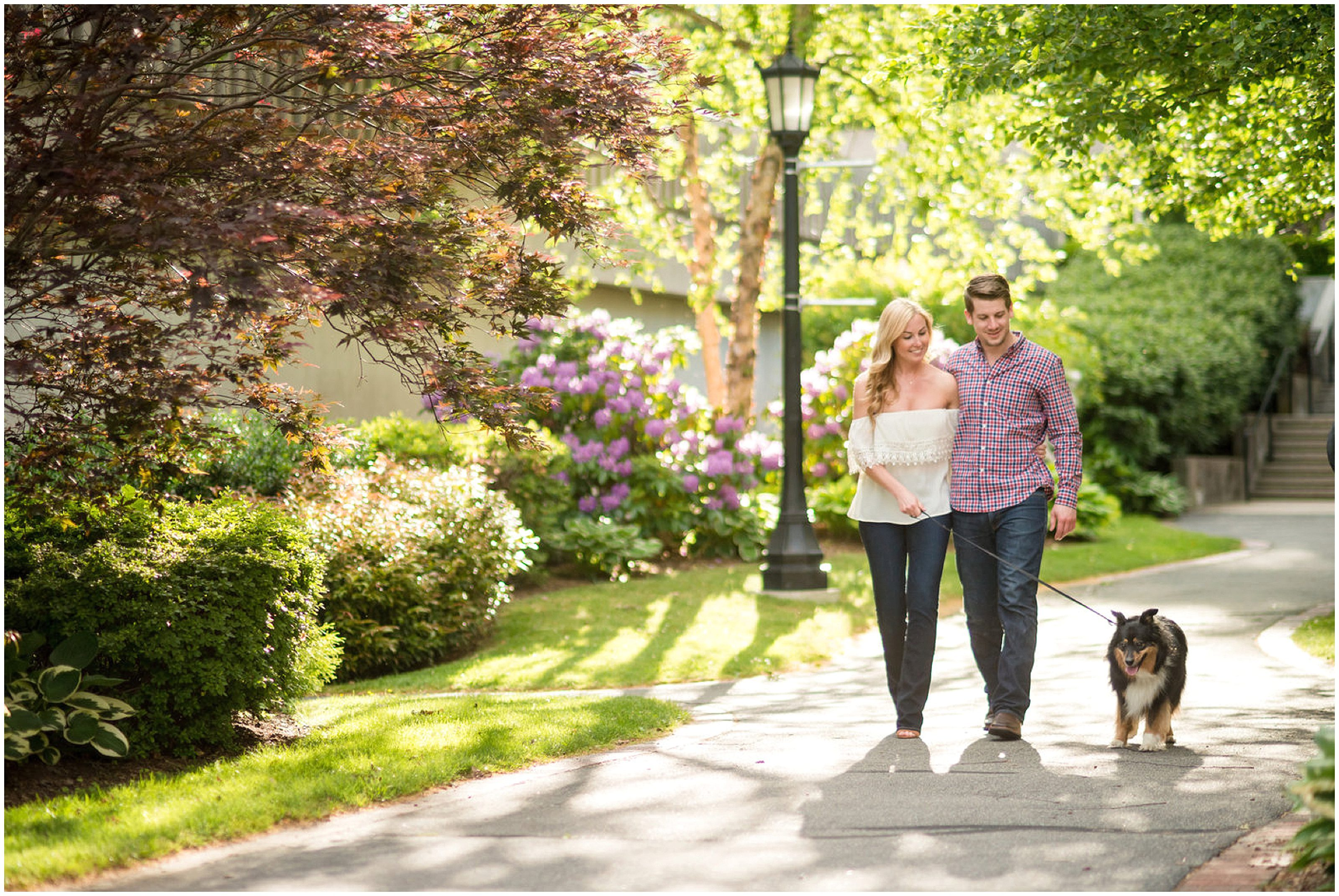 engaged couple walking with dog what to wear for boston photo session