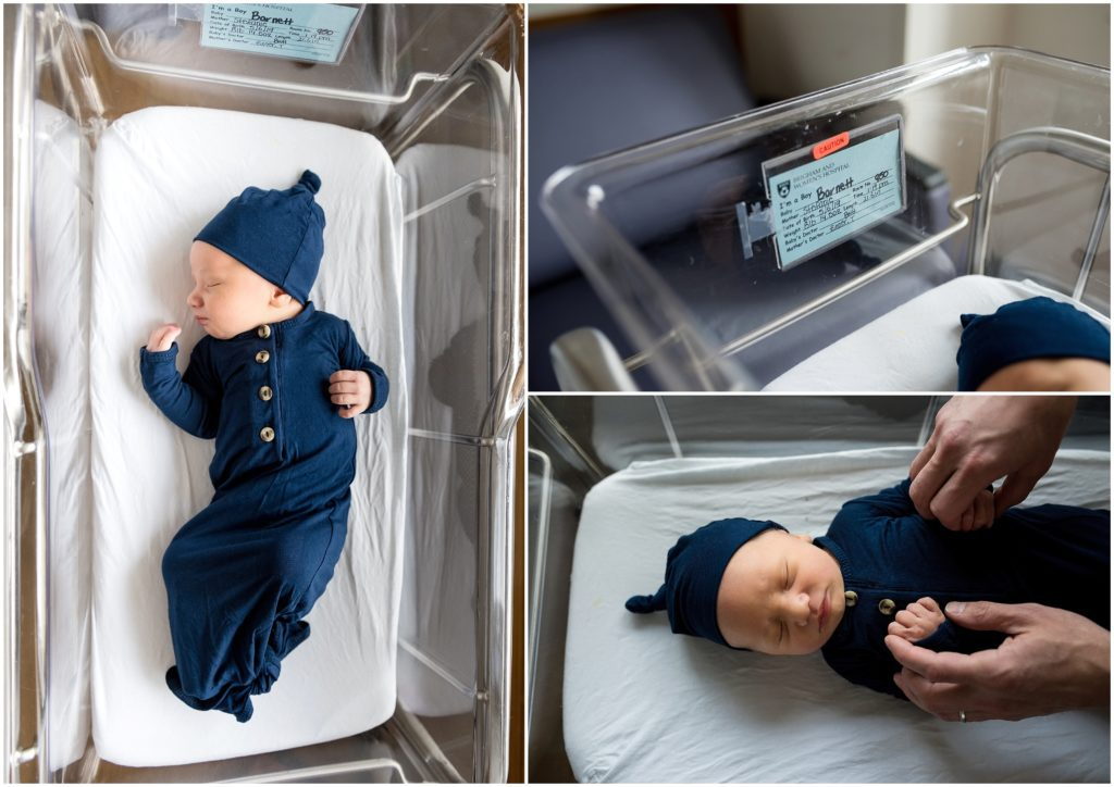 Newborn in knotted onesie in bassinet at hospital