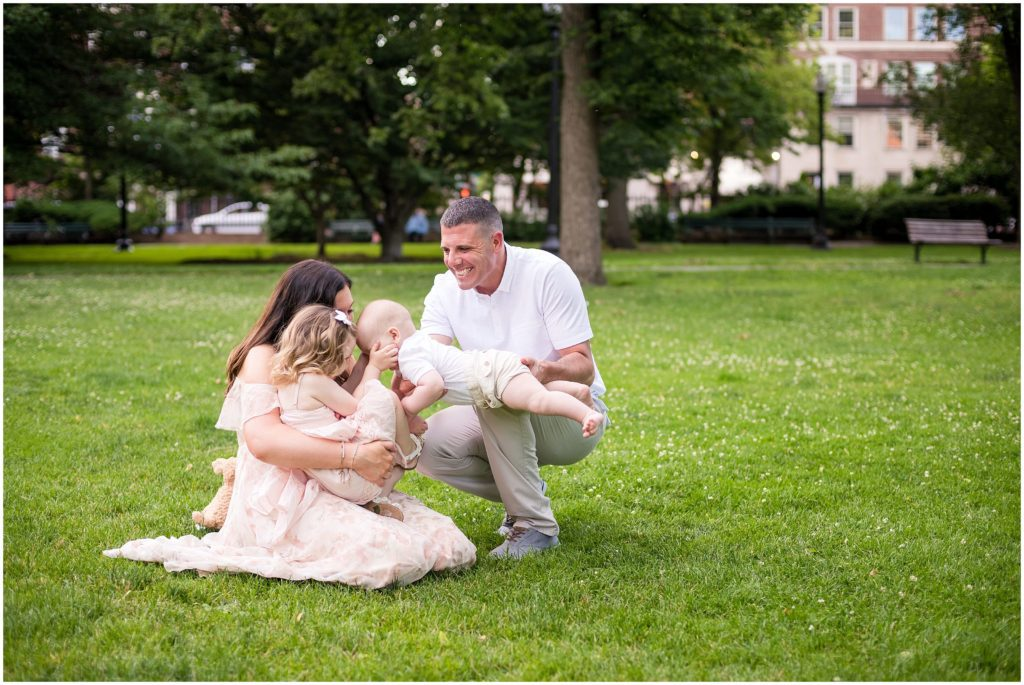 Kisses for baby brother during family session at Boston Public Garden