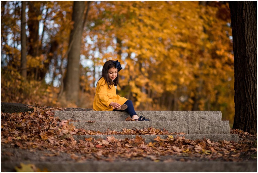Girl sitting on steps in Larz Anderson Park