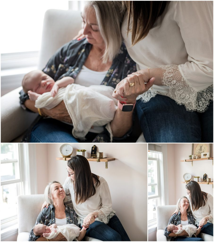 Grandmother holding grandchild and daughter