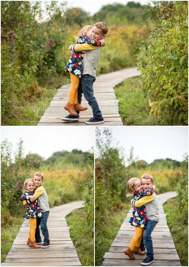 Brother and sister hugging during family session