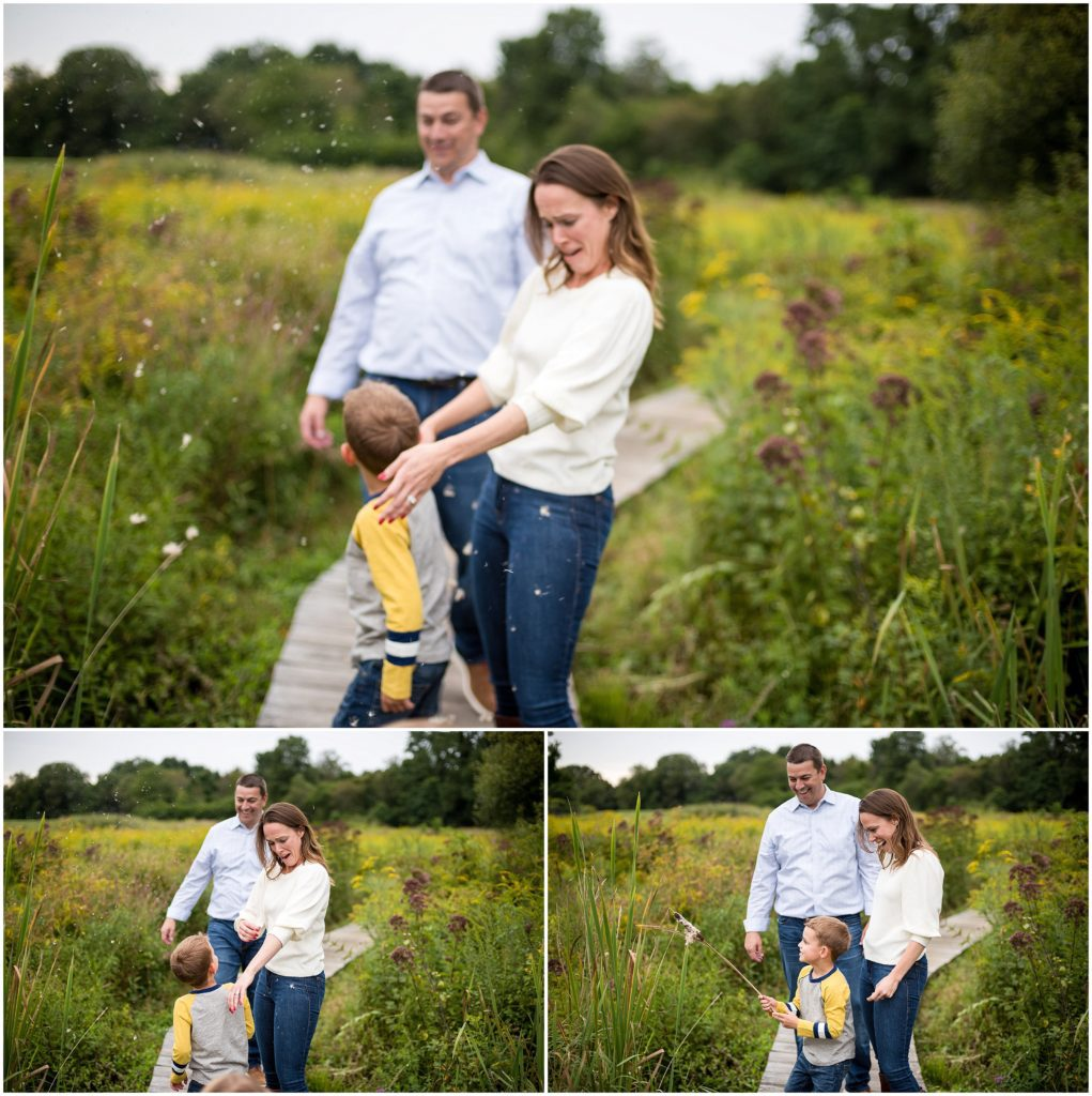 Family playing in field in family photography session