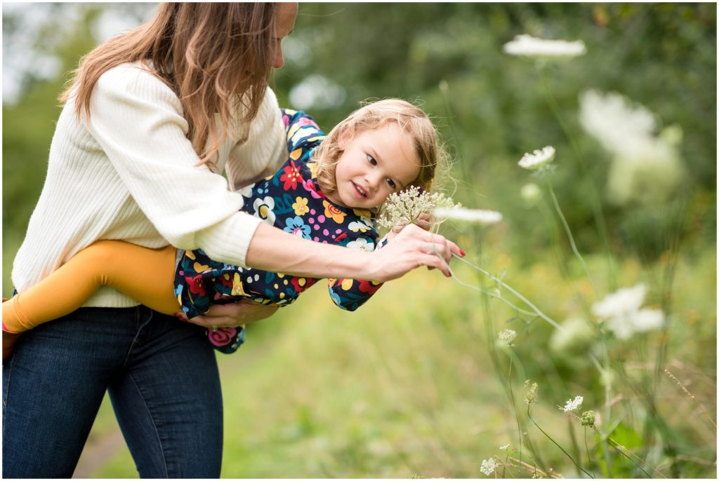 Daughter and mother looking at flowers in Belmont