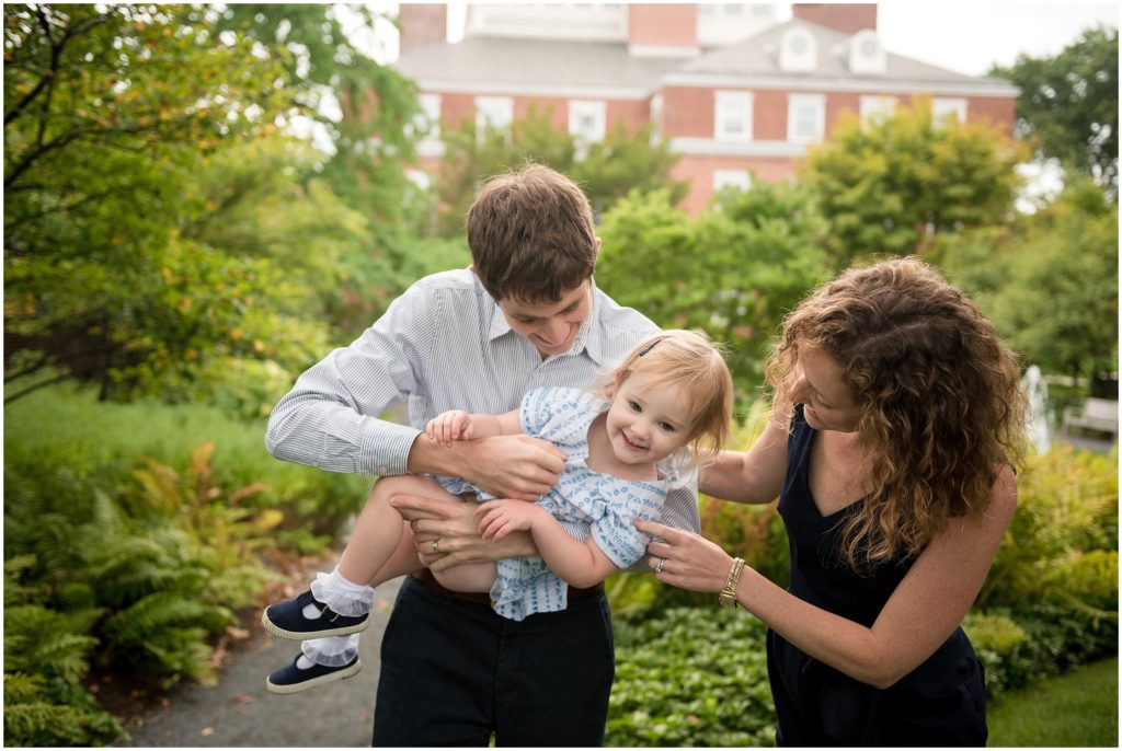 Parents playing with child in Harvard Yard Harvard family photography