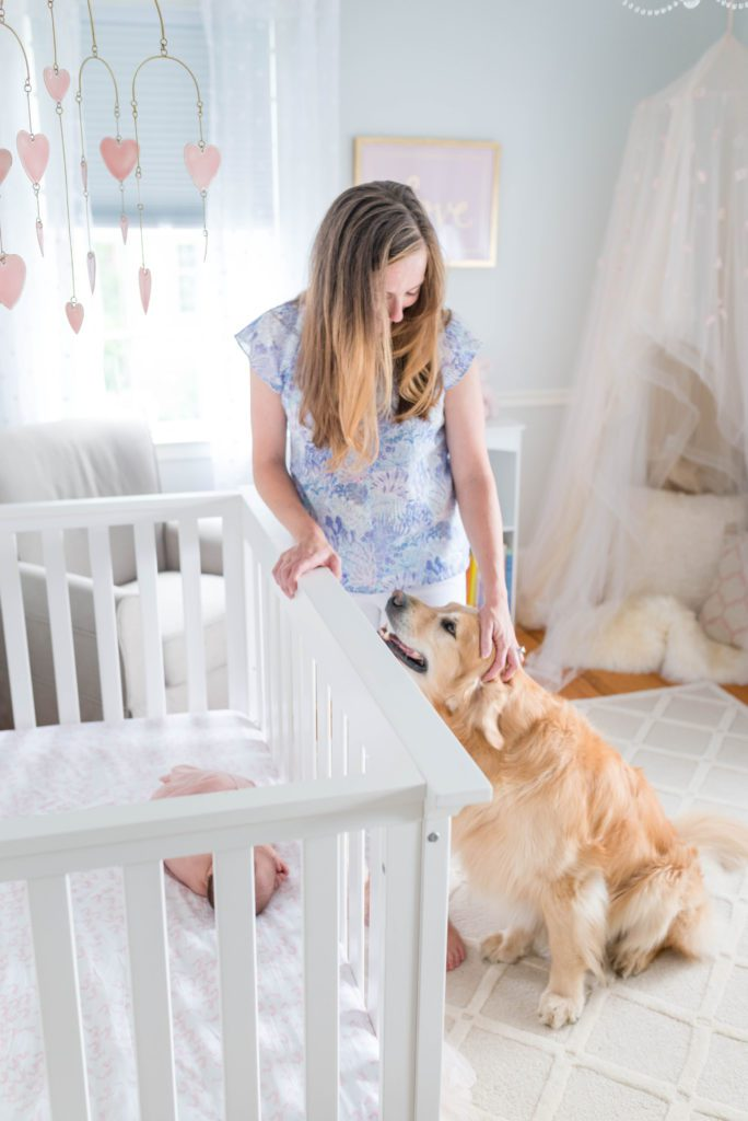 Newborn in crib with mom and pup | newborn photos at home