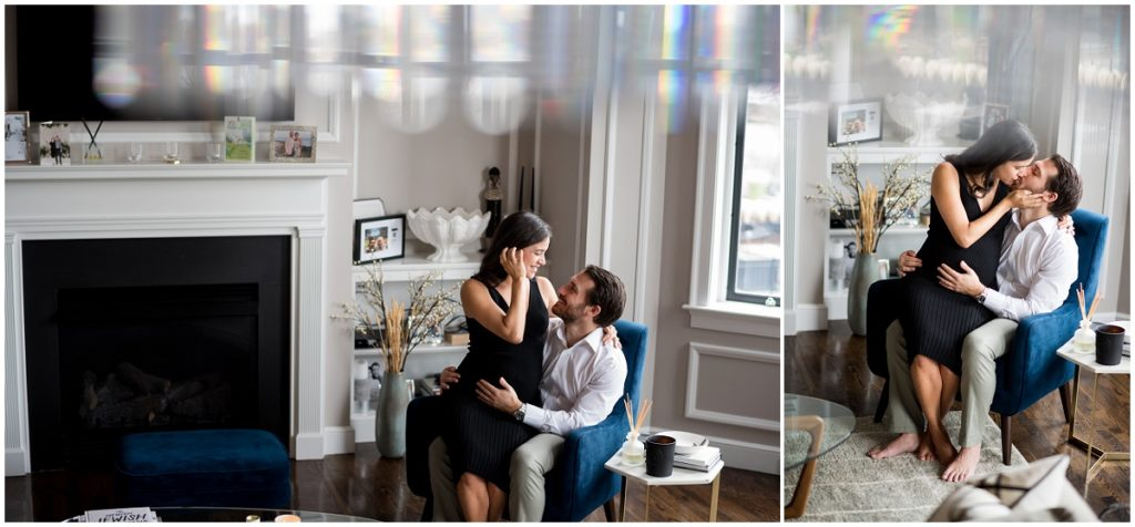 couple kissing on chair at home in Boston lifestyle maternity photography session