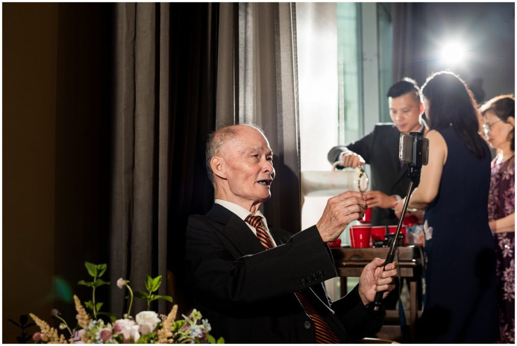 uncle taking selfie during tea ceremony