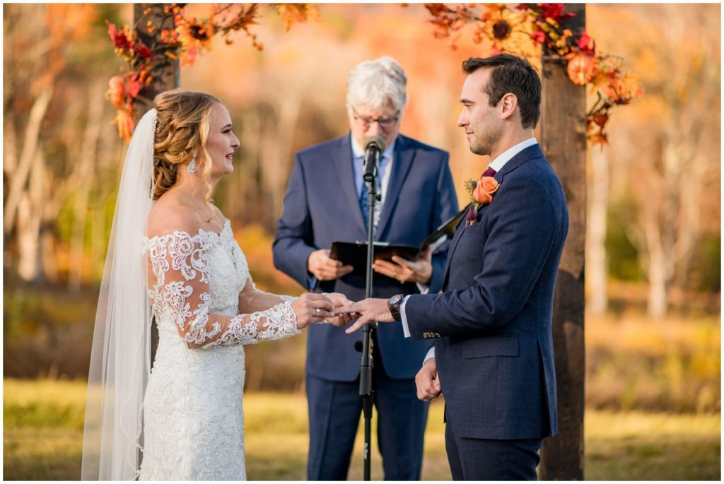 Bride and groom at alter in outdoor ceremony in NH. Barn Wedding in NH