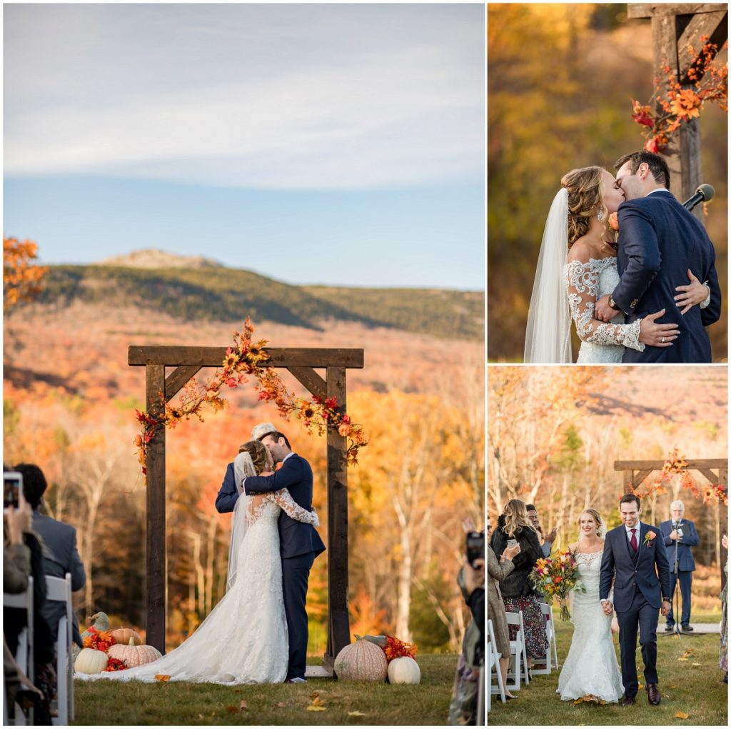 Bride and groom kissing at end of ceremony during NH barn outdoor wedding