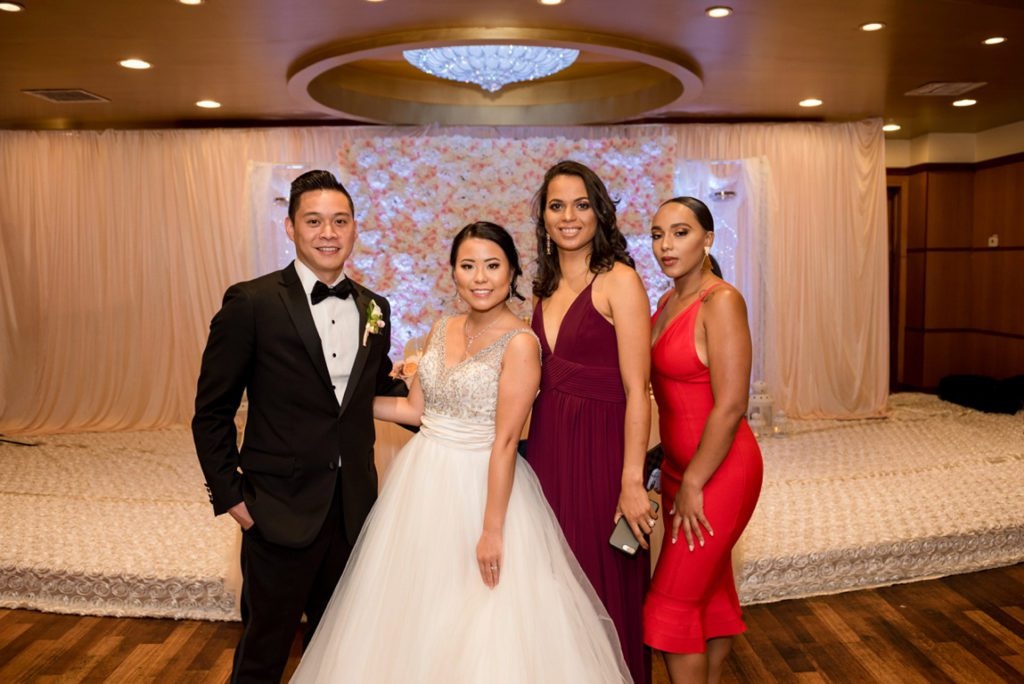 Formal family photos during wedding during reception