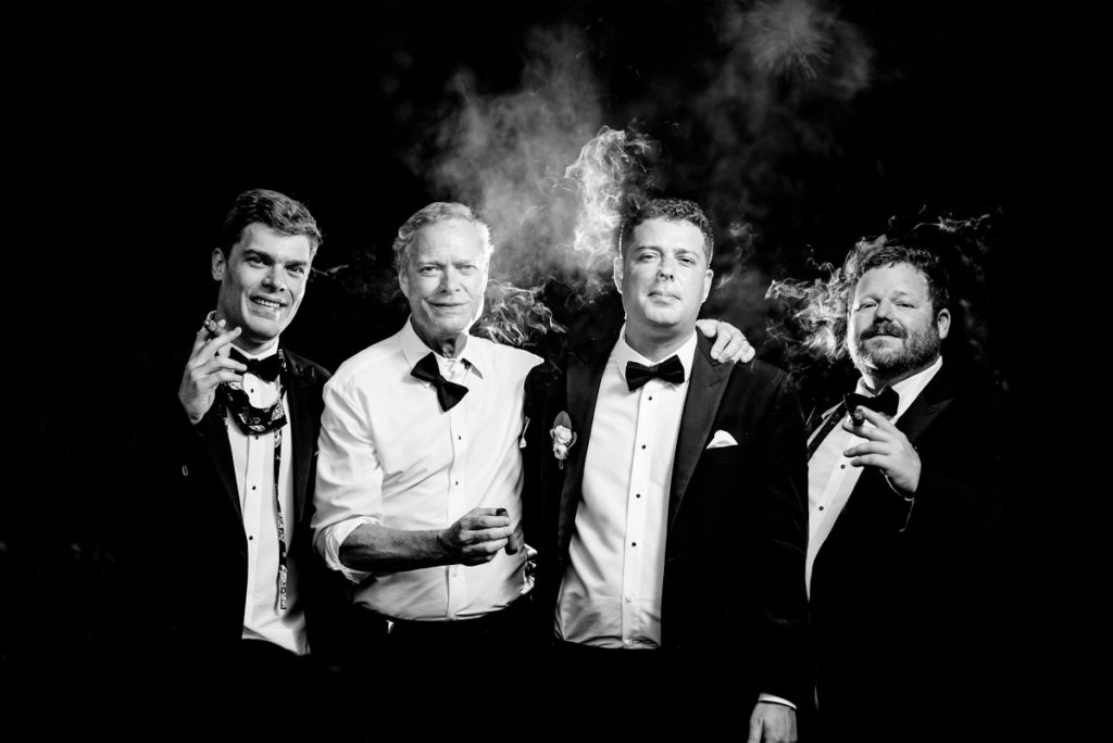 Groom and groomsmen brothers portraits with cigar