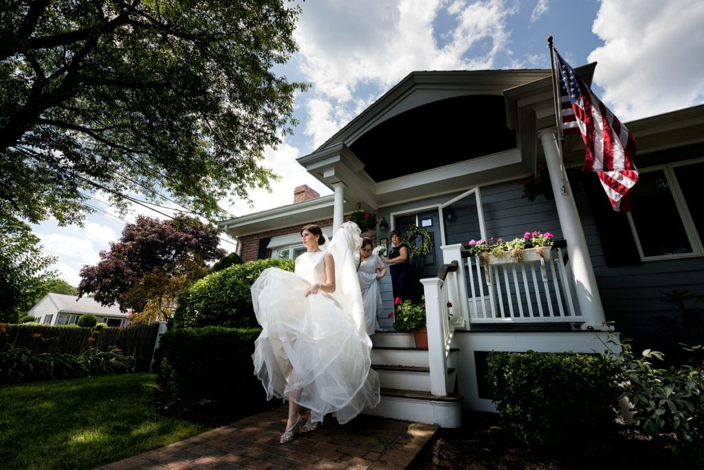 bride exiting her house