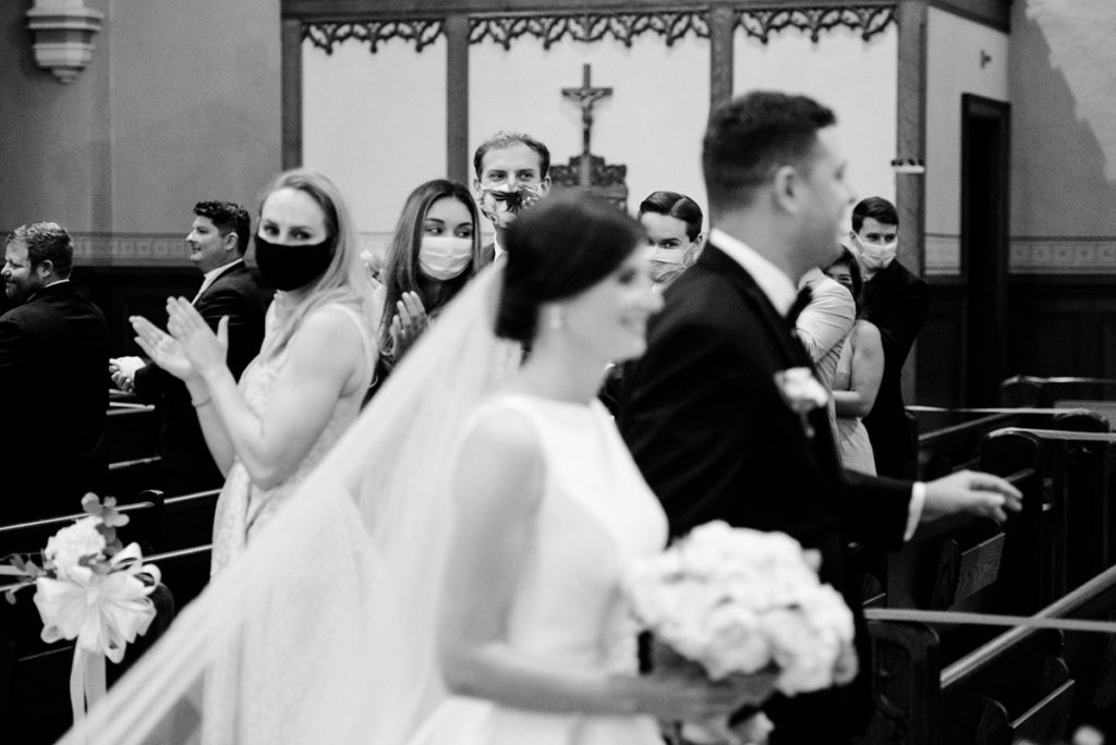 Bride and Groom exiting the church after the wedding