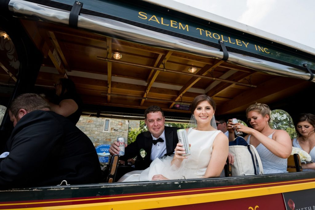 Couple on the trolley after wedding ceremony heading to reception