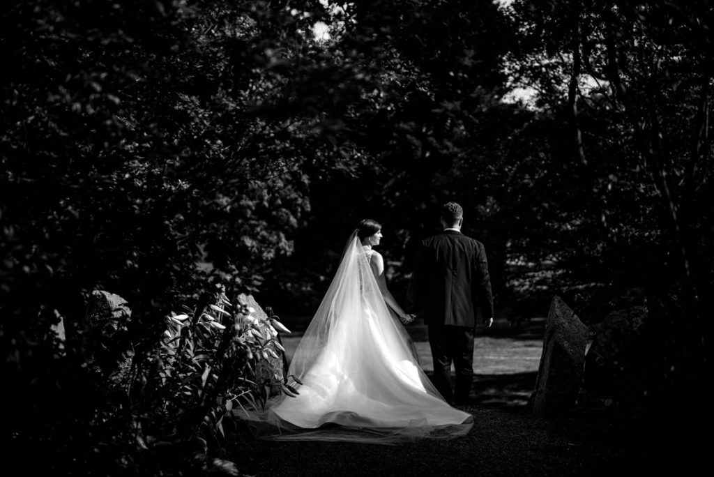 Black and White Couple portraits in the garden at the Estate at Moraine Farm