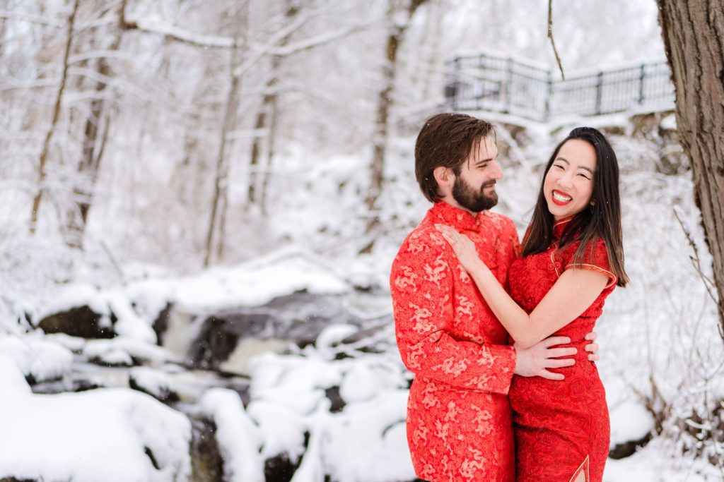 Couple wearing traditional Chinese outfits in their engagement session