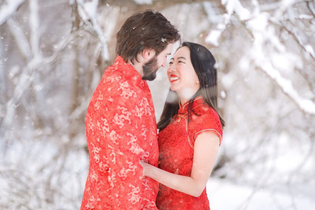 snow falling on couple during their photography session