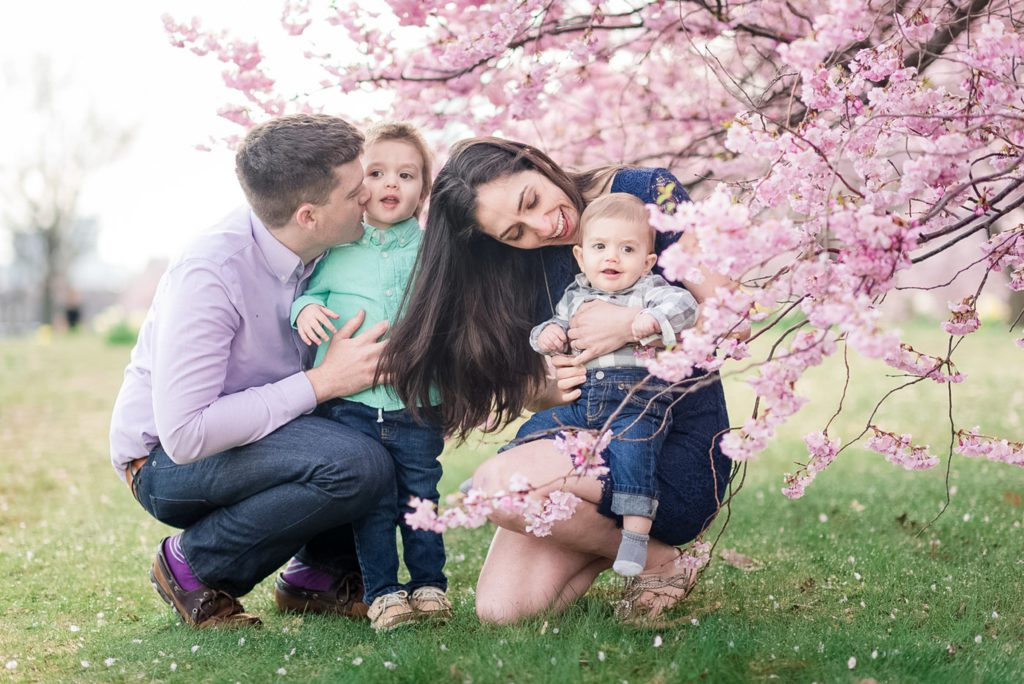 bold outfit colours for an outdoor spring photo session with cherry blossoms in Boston
