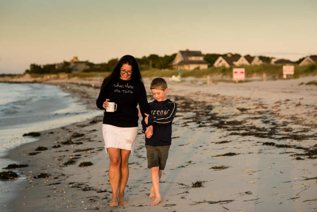 Quiet moment between a mother and sun on the beach in Cape cod during sunrise session