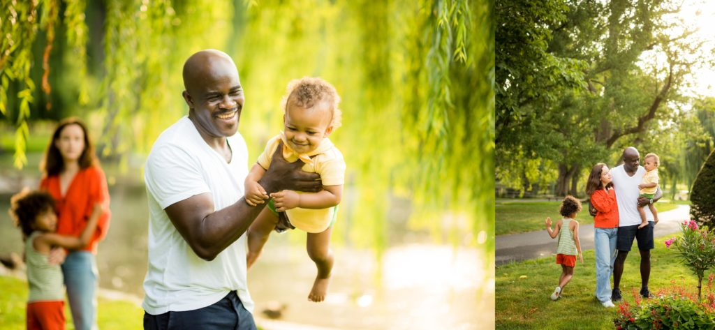 Father playing with child in the park in Boston Public Gardens with kids in cute outfits with flowers blooming