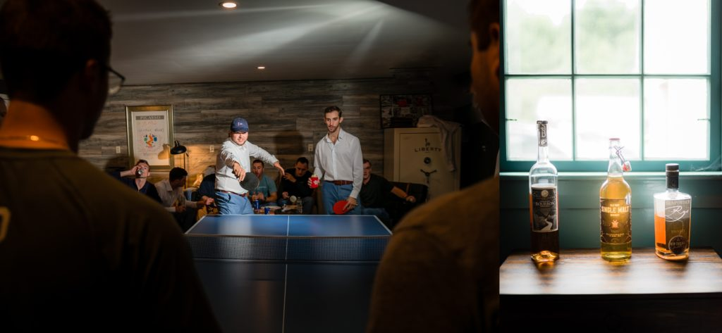 Groom playing ping pong with the guys